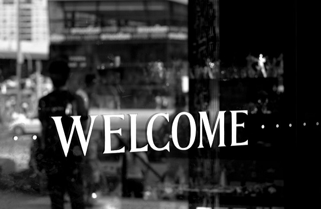 Black and white photograph of Welcome sign