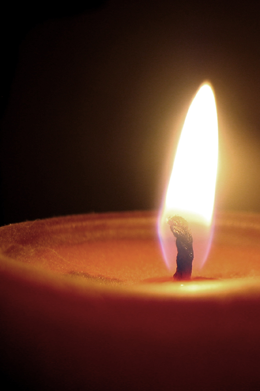 photograph of a single candle flame up close